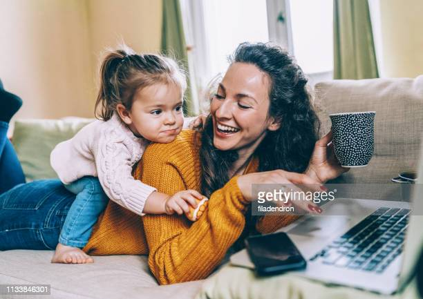 mother and daughter having fun online - surfing the net stock pictures, royalty-free photos & images