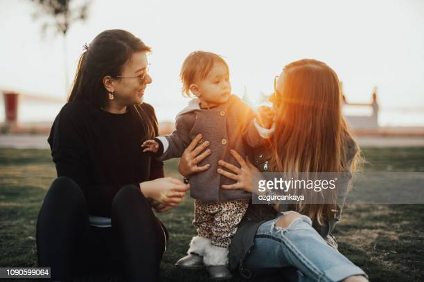 mother and daughter having fun outdoors - aunt stock pictures, royalty-free photos & images