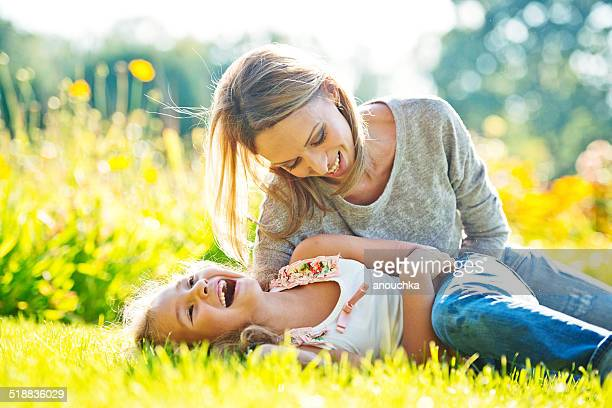 mother and daughter having fun outdoors - adults only photos stock photos and pictures