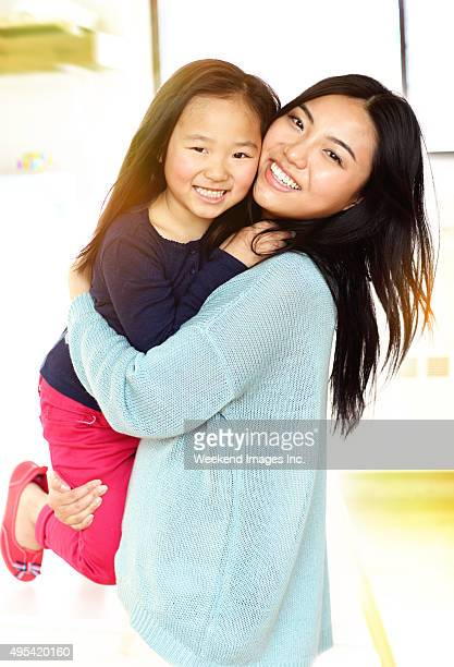 mother and daughter having fun - beautiful chinese girls stock photos and pictures