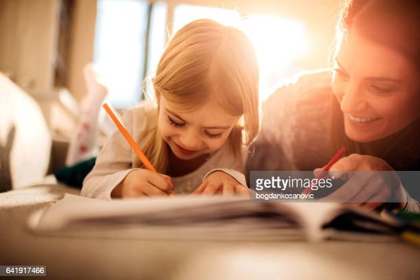 mother and daughter having fun - colouring stock pictures, royalty-free photos & images