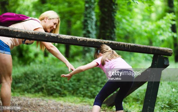 mother and daughter having fun together in the woods - ivanjekic stock pictures, royalty-free photos & images