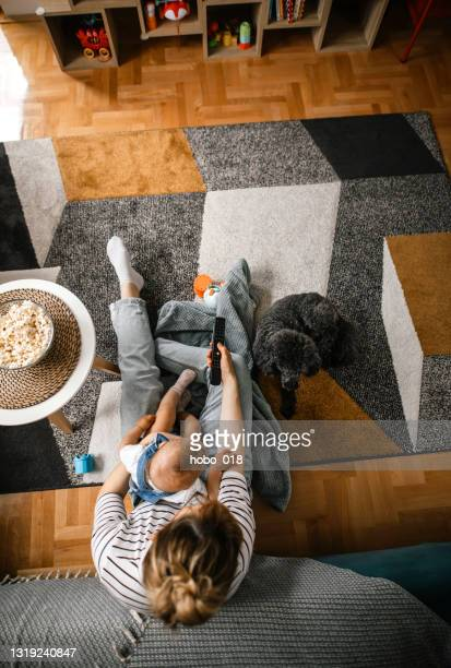 mother and daughter having fun watching tv - cartoon hobo stock pictures, royalty-free photos & images