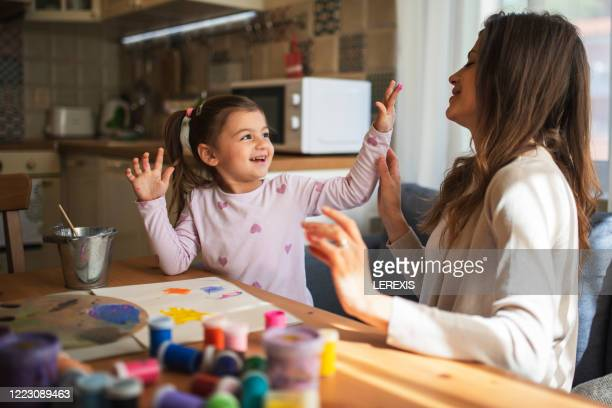mother and daughter having fun while drawing - craft stock pictures, royalty-free photos & images