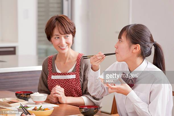 Mother and Daughter Having Japanese Cuisine Breakfast