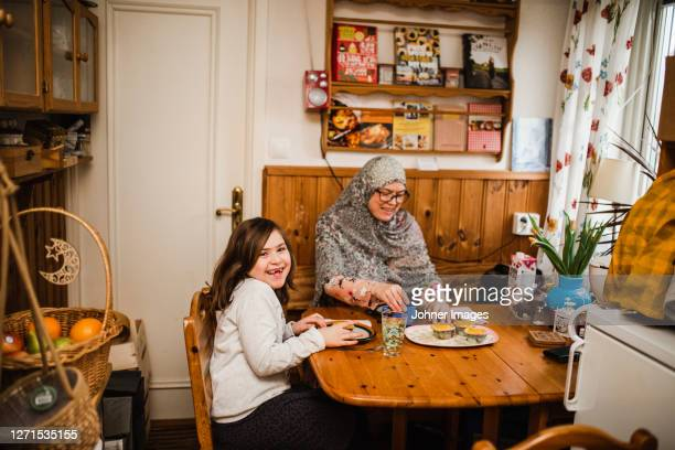 mother and daughter having meal - västra götaland county stock pictures, royalty-free photos & images