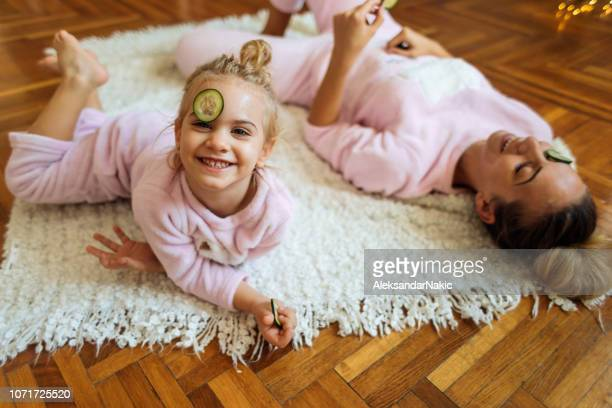 Mother and daughter having natural beauty treatment