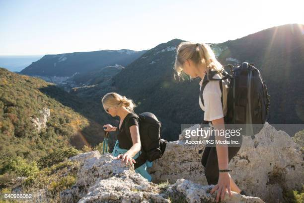 Mother and daughter hike in Mediterranean hills