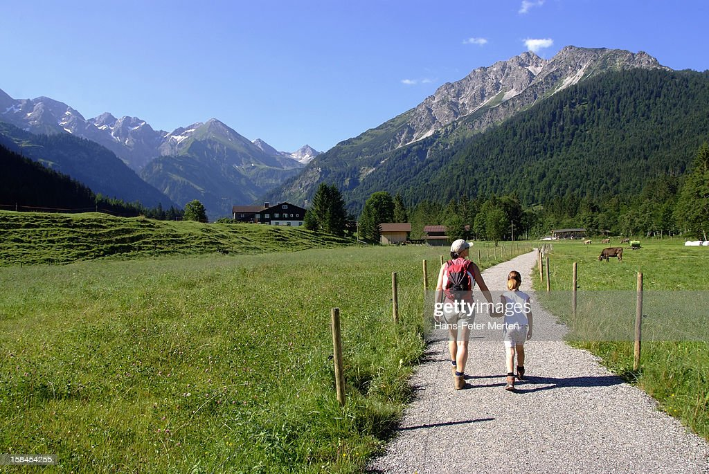 mother and daughter hiking in mountain landscape : Stock Photo