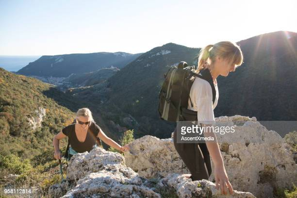 mother and daughter hiking in mountains in sunlight - liguria foto e immagini stock
