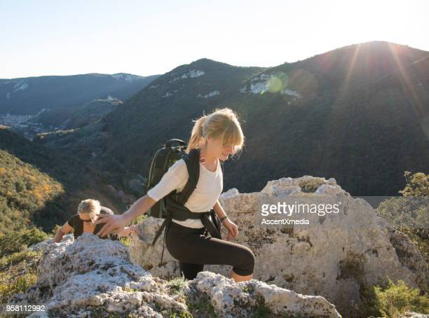 mother and daughter hiking in mountains in sunlight - pedal pushers stock pictures, royalty-free photos & images