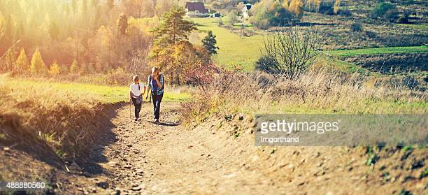 Mother and daughter hiking in the autumn