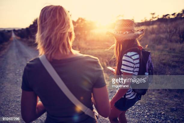 Mother and daughter hiking in Tuscany, Italy
