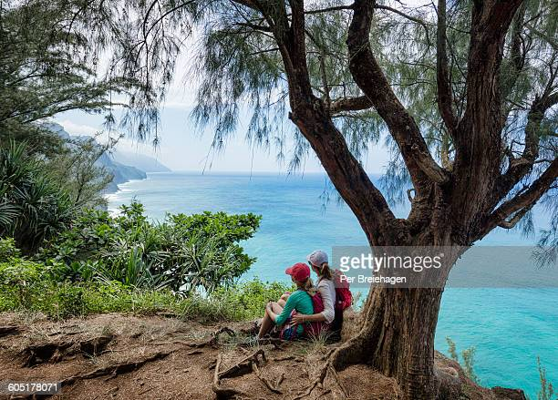 Mother and daughter hiking Na Pali Coast