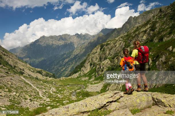 Mother and daughter hiking on the Alps