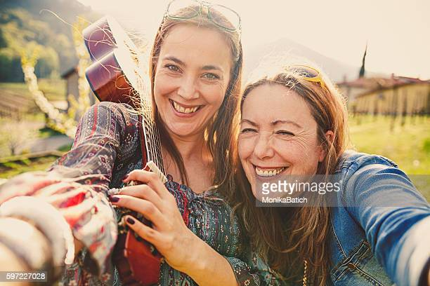 mother and daughter hippie style - hippie woman stock photos and pictures
