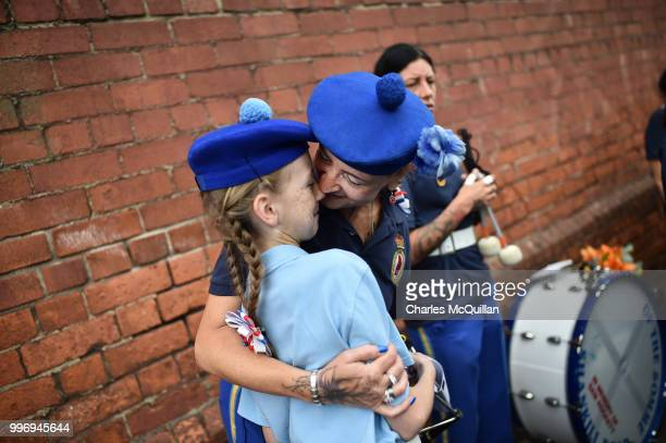 A mother and daughter hug one another before the start of the annual 12th of July Orange march and demonstration takes place on July 12 2018 in...