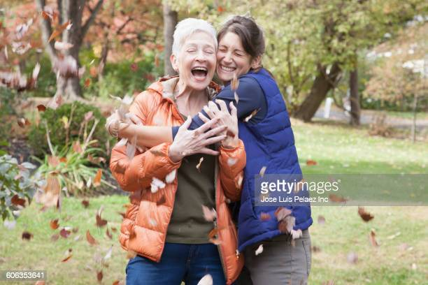 Mother and daughter hugging in leaves