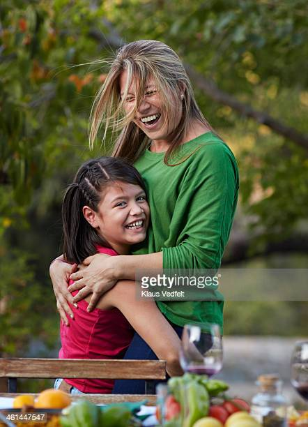mother and daughter hugging & laughing - klaus vedfelt mallorca stock pictures, royalty-free photos & images