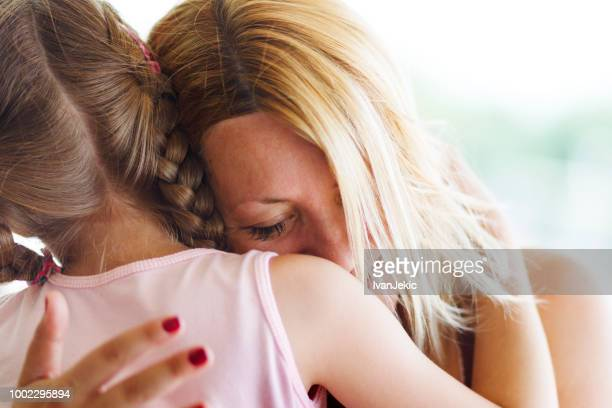 mother and daughter hugging - divorce kids stock pictures, royalty-free photos & images