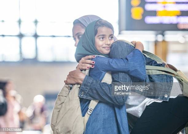 mother and daughter hugging - refugee stock pictures, royalty-free photos & images