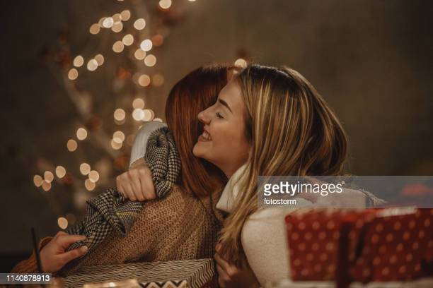 mother and daughter hugging - giving stock pictures, royalty-free photos & images