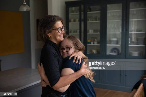mother and daughter hugging - parenting stock pictures, royalty-free photos & images
