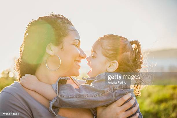 mother and daughter (2-3) hugging - dominican ethnicity stock photos and pictures