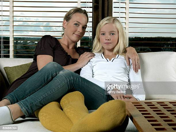 mother and daughter hugging - girls in socks stock photos and pictures
