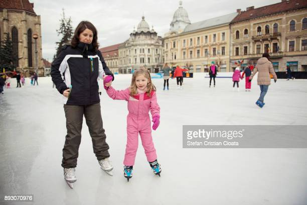 Mother and daughter iceskating