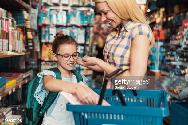 mother and daughter in a bookstore - serbia stock pictures, royalty-free photos & images