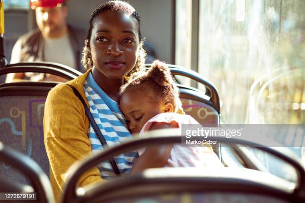 mother and daughter in a bus - on the move stock pictures, royalty-free photos & images