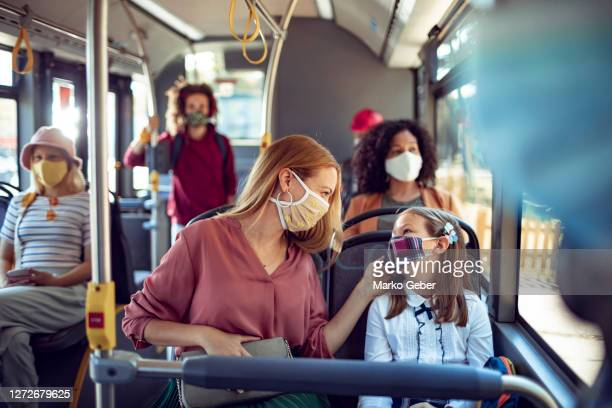 mother and daughter in a bus - public transport stock pictures, royalty-free photos & images
