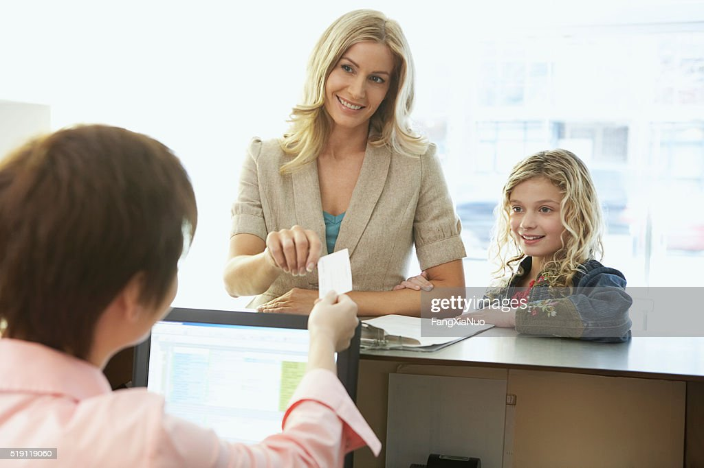 Mother and daughter in a medical office : Stock Photo