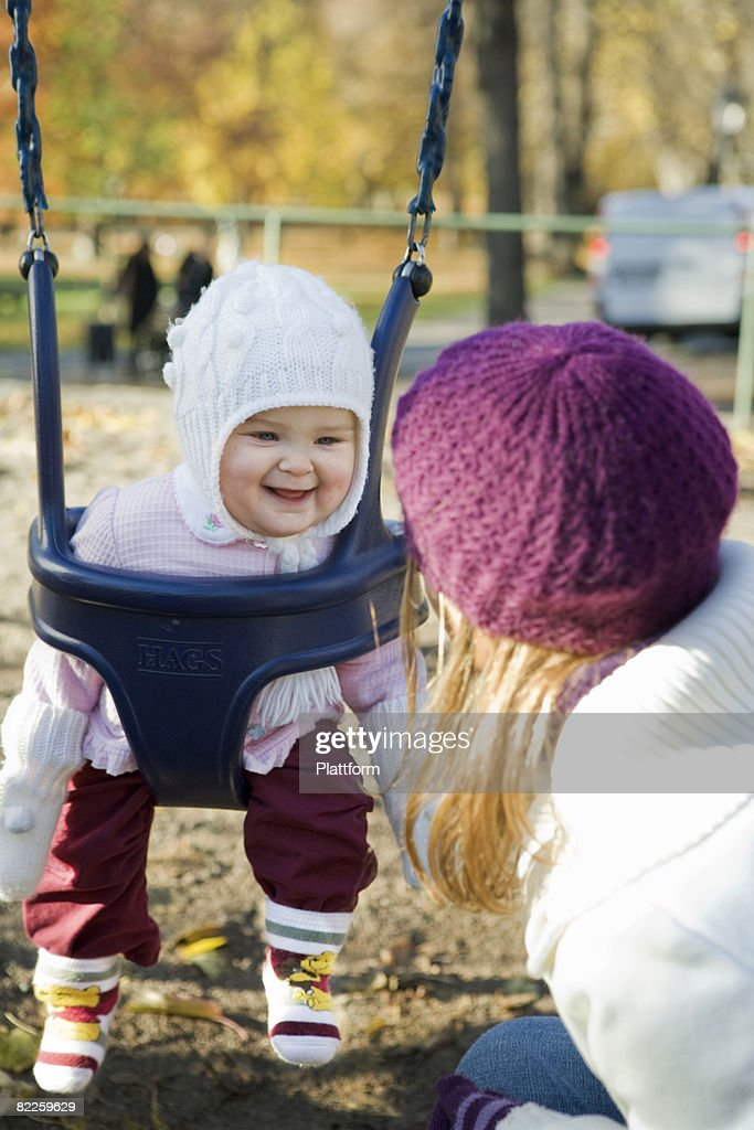 Mother and daughter in a playground Sweden. : Stock Photo
