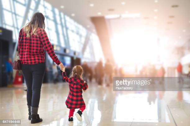 Mother and daughter in airport