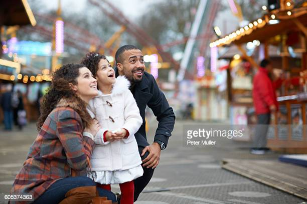 mother and daughter in amusement park looking up smiling - amusement park stock pictures, royalty-free photos & images