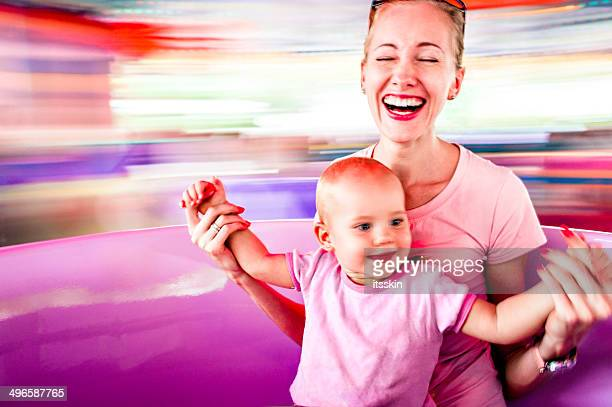 Mother and daughter in amusement park
