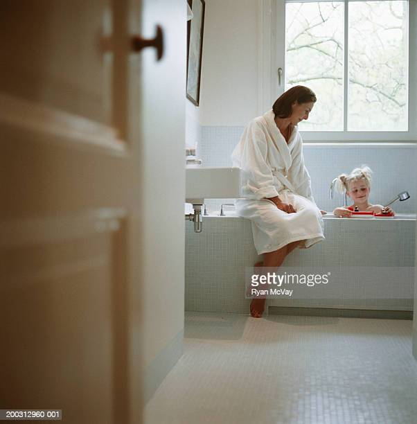 Mother and daughter (2-3) in bathroom