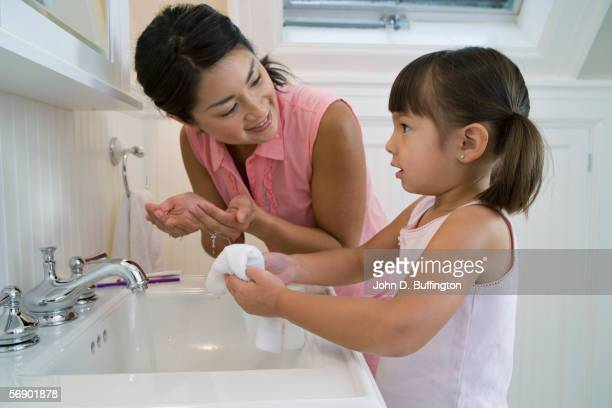 mother and daughter in bathroom - pretty vietnamese women stock pictures, royalty-free photos & images