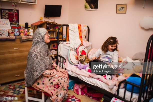 mother and daughter in bedroom - västra götaland county stock pictures, royalty-free photos & images