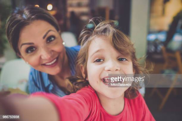 Mother and daughter in cafe