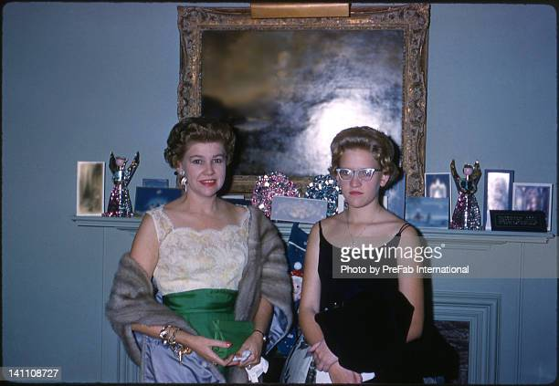 Mother and daughter in front of fireplace mantle