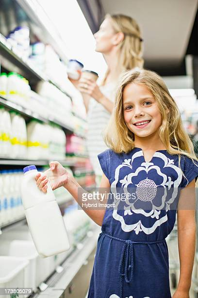 mother and daughter in grocery store - milk carton stock photos and pictures