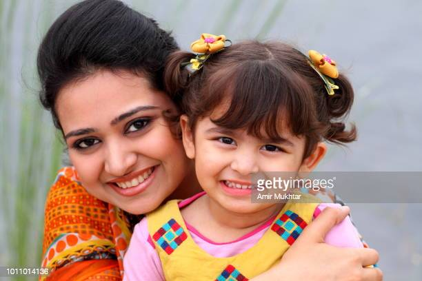 mother and daughter in happy mood - punjab pakistan stock photos and pictures