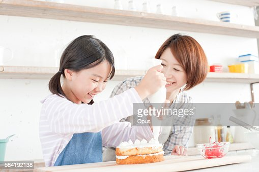 mother and daughter in kitchen decorating cake hyogo prefecture
