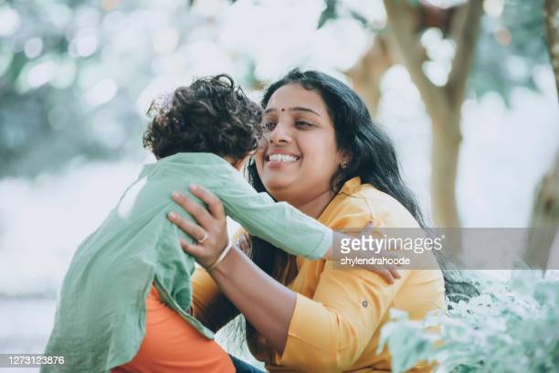 mother and daughter in park - primary age child stock pictures, royalty-free photos & images