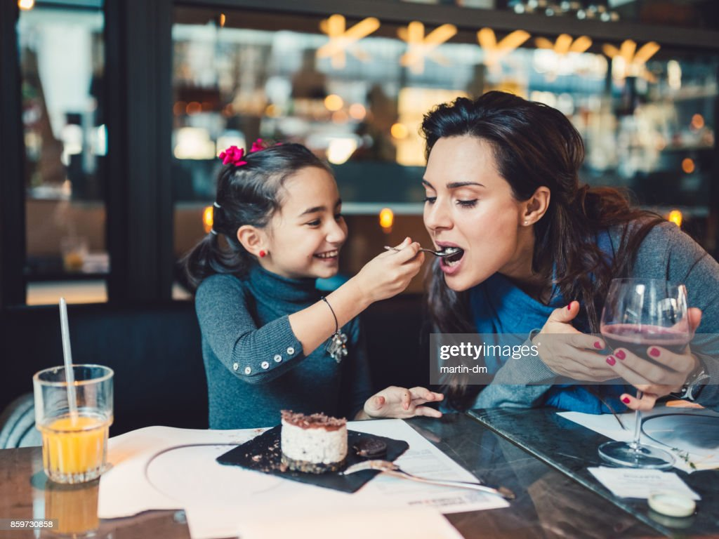 Mother and daughter in restaurant : Stock Photo