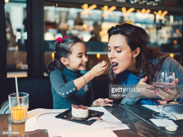 mother and daughter in restaurant - aunt stock pictures, royalty-free photos & images