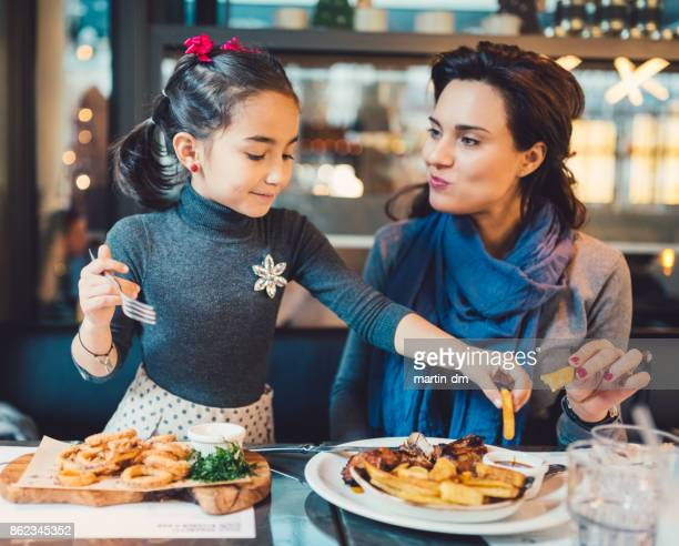 mother and daughter in restaurant - the brunch stock pictures, royalty-free photos & images